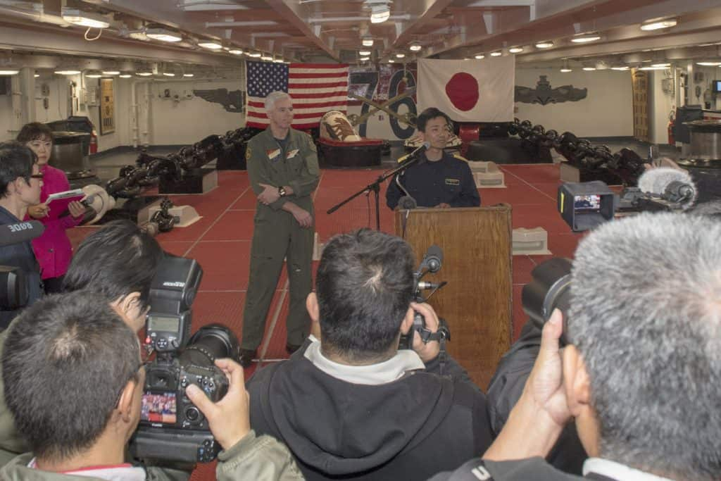 Japanese Rear Adm. Hiroshi Egawa, commander of Escort Flotilla 1, and U.S. Navy Rear Adm. Karl O. Thomas, commander of Task Force 70, hold a news conference with Japanese media aboard the aircraft carrier USS Ronald Reagan during Keen Sword 2019 In the Philippine Sea, Nov. 3, 2018.